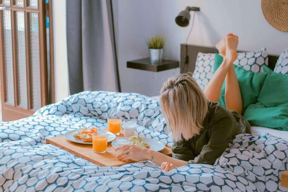 woman chilling with breakfast in bed