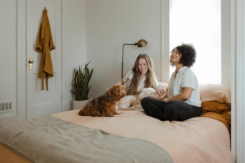 two women and dog in a room rental singapore