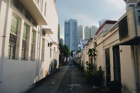 back alley with a view of skyscrapers